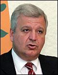 Christ Protoplasts, πρώην κυβερνητικός εκπρόσωπος